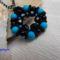 kék fekete medál