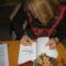 Antal Judit dedikálja könyvét