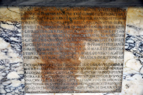 Latin inscription with the names of many saints