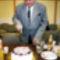 Farkas Nándor a 100 Tagú Cigányzenekar Fötitkára/Managere a születésnapi torta szeletelése közben :)