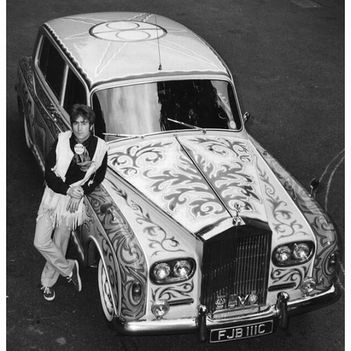 john_lennon_1967poses with his psychedelic rolls royce