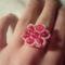 rózsaszín virágos gyürü