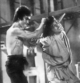 bruce lee & Jackie Chan (enter the dragon)