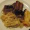 Frissen vágott sertéssült párolt káposztával és burgonyával.