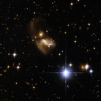 3604625976_Hubble Interacting Galaxy IRAS 21101