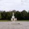 56os emlékmű az új köztemető 301-es parcellájánál, előterében a mártírok sírhelyei
