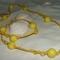 sárga csomózott nyaklánc