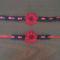 20110829220-fekete nyakek es karkoto, piros szallaggal,piros viraggal kozepen fekete gyonggyel