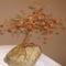 Első fám: borostyán és egyéb féldrágakő felhasználásával