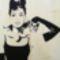 Audrey_Hepburn_cicaval_intarzia_kép