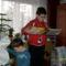 unokáim a karácsoni ajándékot bontogatják